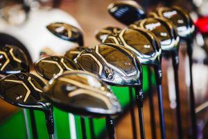 A set of black golf clubs for rent