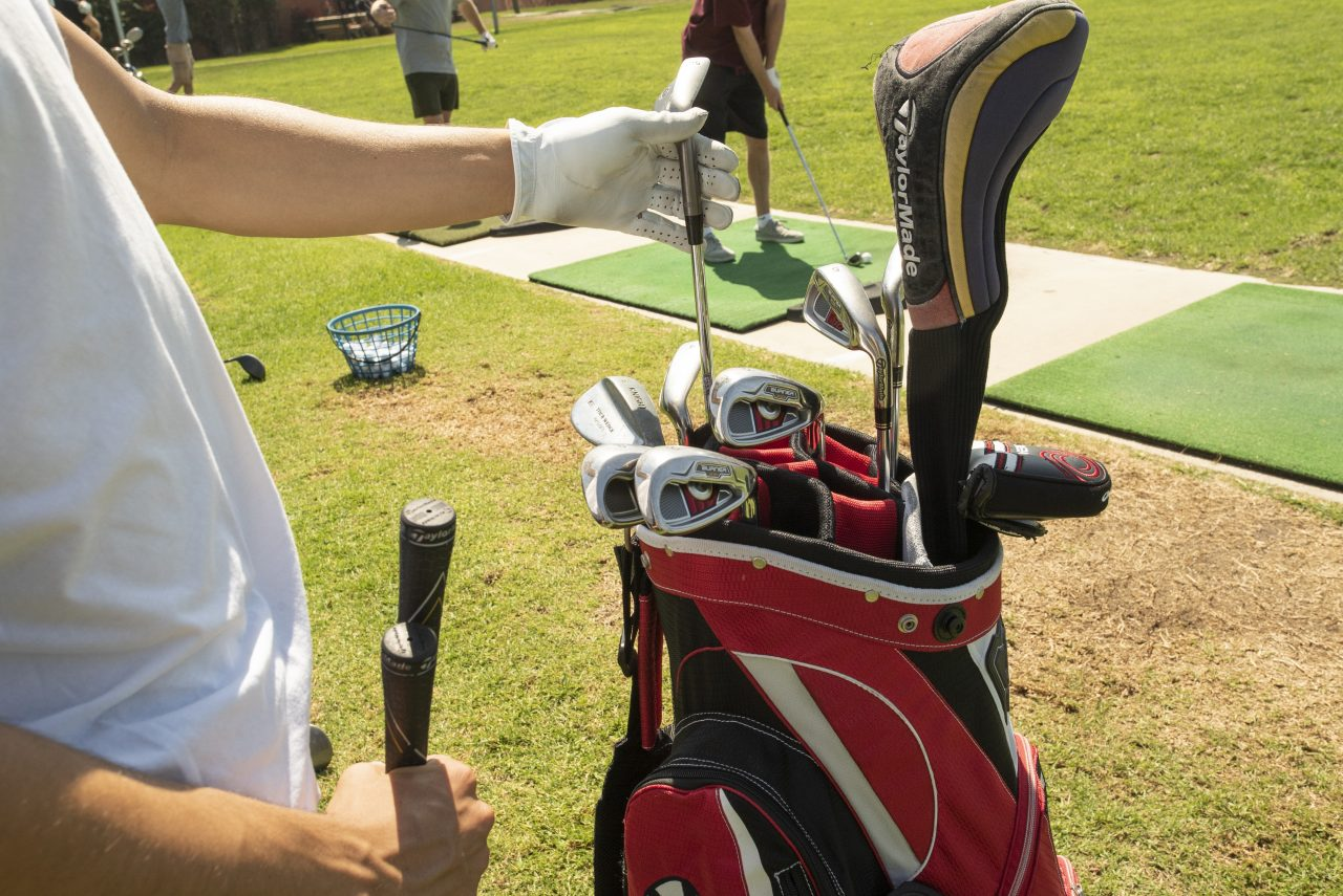 a rental set of clubs being played on the driving range in san diego